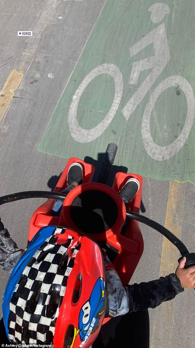 Weee! Earlier that day, Graham Instastoried a snap of their 14-month-old son Isaac Menelik Giovanni sporting a Cars-themed helmet while riding on the Venice Beach bike path