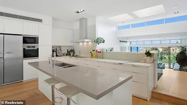 Luxury: The kitchen features a Calacutta marble benchtop and a Caesarstone breakfast island