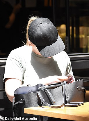 Looking for something?  Meanwhile, Melissa sat patiently waiting for her coffee to go as she rummaged through her purse