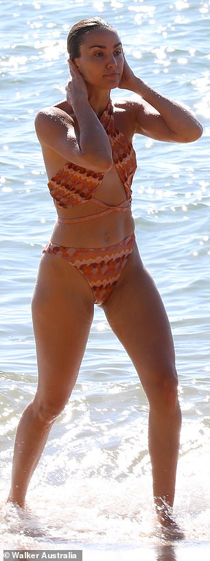 So hot she needs to cool down! Rachael put her enviable abs and lean pins on display as she splashed about in the shallows
