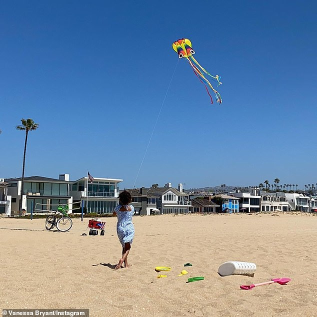 Kite time:Bryant's first post on Wednesday, which comes after she shared Easter Sunday pics with friend Ciara and her family, featured Bianka, 4, flying a kite while wearing a blue and white polka dot dress