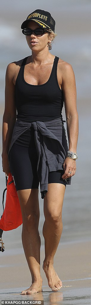 She wore a black swimsuit and shorts for the outing