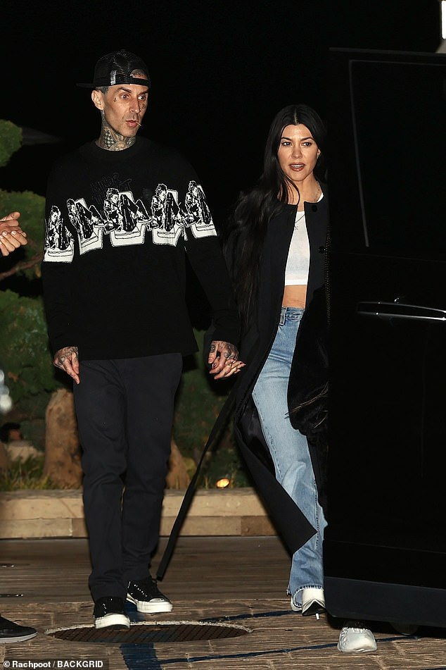 The latest: Kourtney Kardashian, 41, and boyfriend Travis Barker, 45, were pictured visiting celebrity Malibu on Wednesday night, as their spring romance continues to blossom.