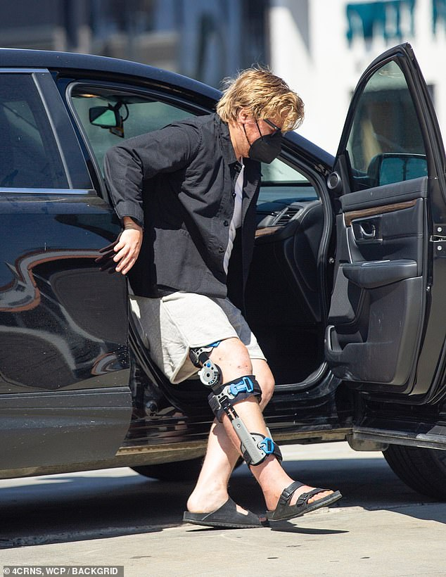 Relaxed Fit: Jesse wore comfortable clothes to keep his leg exposed and movable, including gray sweat shorts he wore with a white t-shirt and light jacket