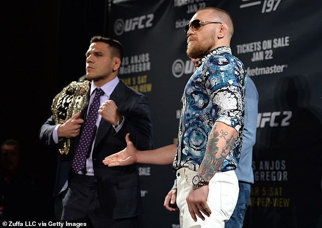 McGregor (R) told Rafael dos Anjos (L) that it is 'red panty night' when you sign to fight him