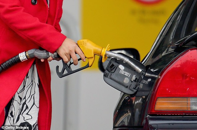 New petrol and diesel cars could be banned by 2030 under a state government plan for zero transport emissions. Pictured is a Honda Prelude being refuelled with unleaded in Melbourne