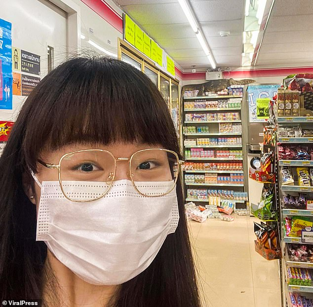 Customer Narumpa Tangsin, who filmed the creature, said: 'They're dangerous animals, especially when they're angry, so I stayed back and recorded it on my phone. I guess that shops have everything, even for lizards'