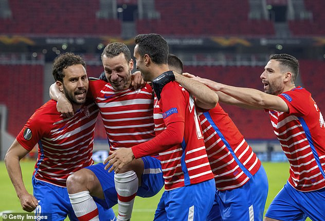 Former Tottenham striker Roberto Soldado (second left) celebrates with his Granada team-mates after scoring against Molde in the last round