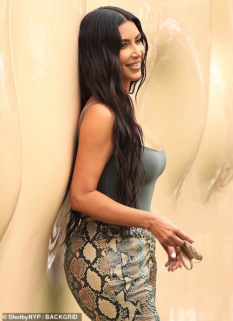 Jovial:She appeared to be in a jovial mood as she smiled for the cameras, despite currently being in the midst of a divorce from her estranged husband Kanye West