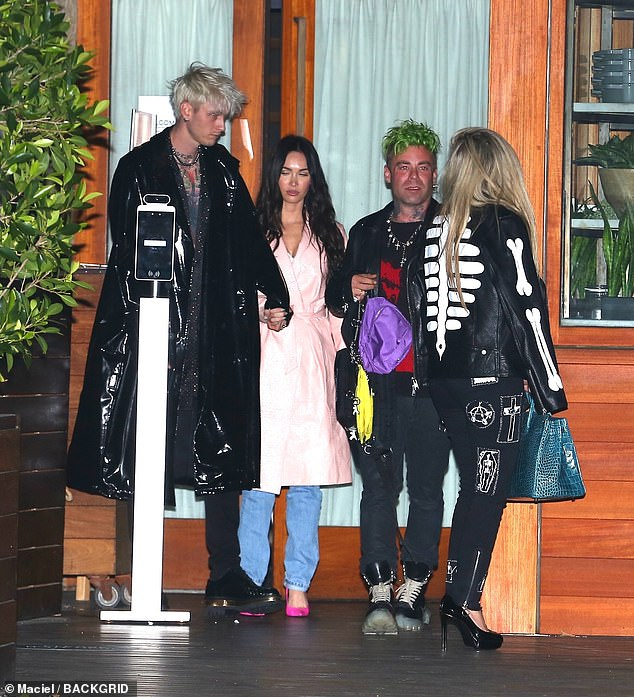 Departure: The quartet were seen leaving the restaurant together after their night out