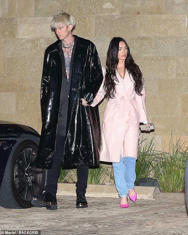 Wow!  Megan looked sensational on the double date as she wore a pink mac coat over a simple white shirt and slightly faded denim jeans, as she and Kelly walked hand in hand inside.