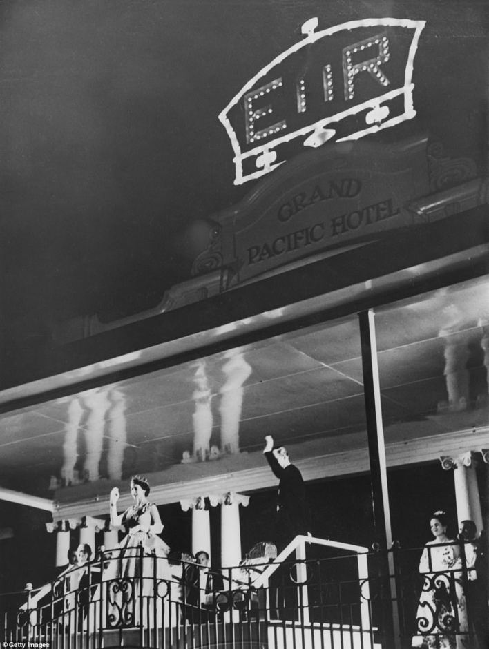 Queen Elizabeth II and Prince Philip wave to crowds from the balcony of the Grand Pacific Hotel in Suva, Fiji, in December 1953