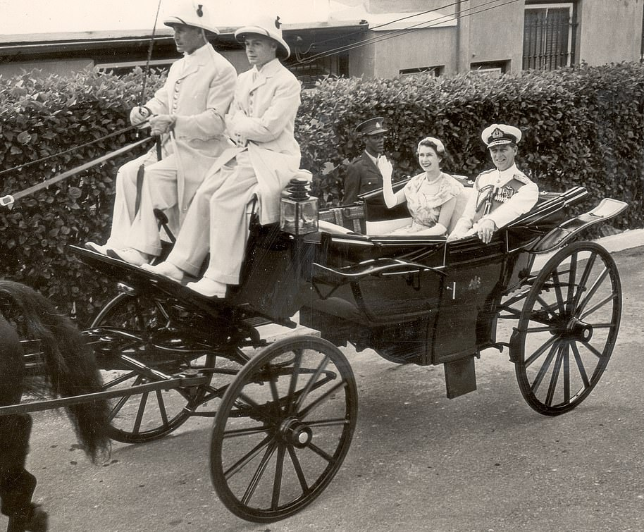 The Queen with the Duke of Edinburgh in their horse drawn carriage in Hamilton, Bermuda, during their tour in November 1953