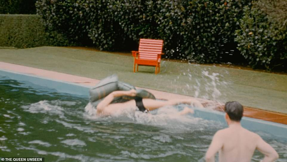 The Duke of Edinburgh struggles to climb onto a lilo in the pool on Christmas Day 1953 as part of rare and unseen private home movie which gives a glimpse of Philip and the young Queen off duty while staying in New Zealand