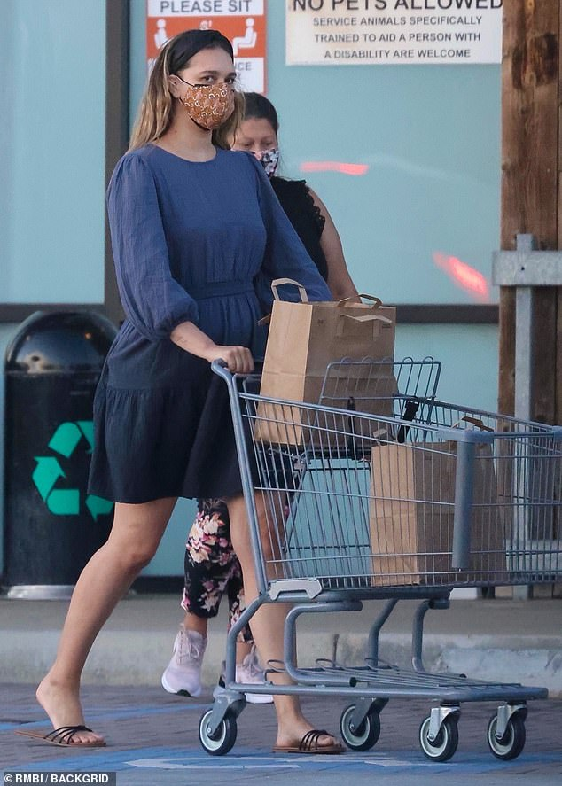 Staying Safe: April Love Geary made sure to protect herself from the coronavirus on Wednesday as she sported a face mask and shaded smock dress for a shopping spree in Malibu, Calif.