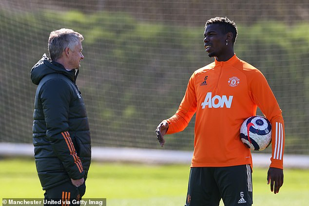 He believes Haaland would suffer at United like Paul Pogba (R) after his initial struggle for form