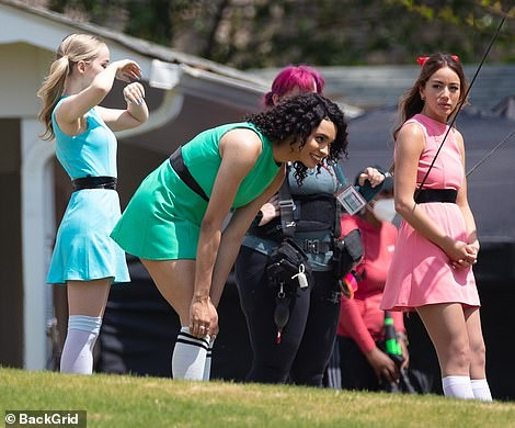 Old school: All three wore sleeveless mini dresses cinched around their waists with black belts, as well as white knee-high socks