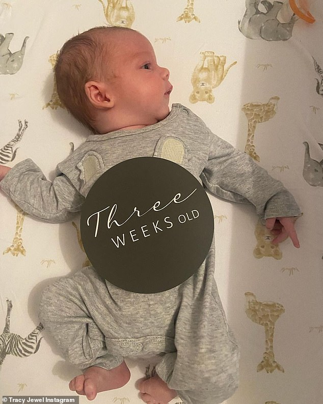Adorable: The 37-year-old shared a series of photos of her newborn, including one of him with a 'three weeks old' sign. She said in the caption:'We welcomed you earthside three weeks early. You fought your way through those first 5 days'
