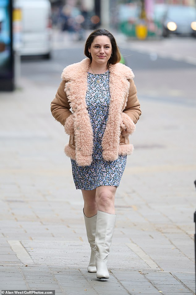 Florals for spring: Kelly Brook had a spring in her step as she headed through Leicester Square wearing a mini dress for work at Global Radio Studios in London on Thursday