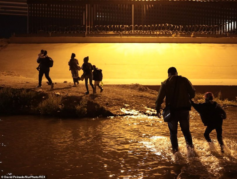A family from Haiti crosses the Rio Grande on March 30 to claim asylum in the U.S.