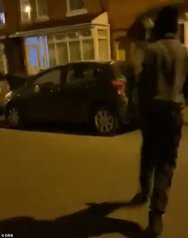 The balaclava-clad thief was filmed posting a wad of notes through the victim's letterbox in Small Heath, Birmingham, on Easter Monday