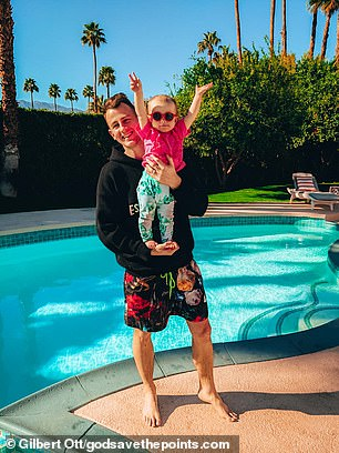 Gilbert with his baby daughter in Palm Springs earlier this year