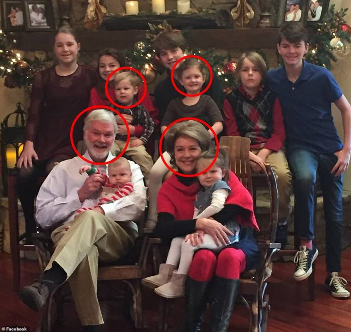 This photo showing Dr Lesslie, his wife and their two grandchildren who perished in the massacre on Wednesday (circled in red)