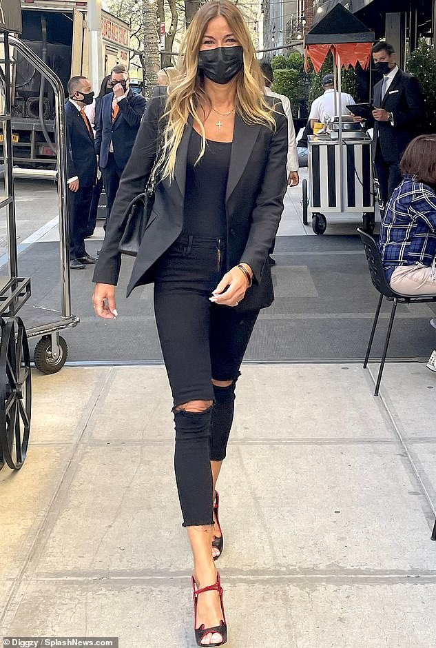 Mover and shaker:She slid her statuesque figure into a skintight black outfit while stepping out for lunch on the Upper East Side of Manhattan