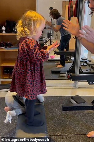 Joe Wicks, 34, took to his Instagram Stories on Wednesday as he said it was 'chaos' in his home gym with his wife Rosie, 30, and his two children Indie, two (pictured), and Marley, 16 months.
