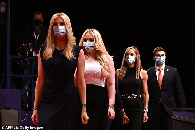 Daughter and Senior Advisor to the US President Ivanka Trump, daughter of the US President Tiffany Trump, campaign adviser to the US President and Eric Trump's wife Lara Trump wear facemasks as they arrive to attend the final presidential debate at Belmont University in Nashville, Tennessee, on October 22, 2020
