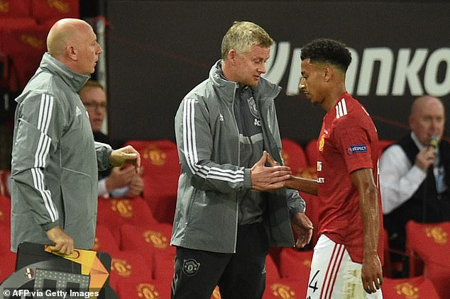After a rebuke from Ole Gunnar Solskjaer (middle), Lingard revealed the truth to the manager