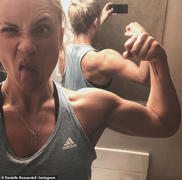 Gym life:Many snaps show Danielle showing off her ripped physique in the gym and flexing her toned muscles for the camera