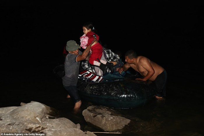 Migrants, departing from Honduras, Guatemala and El Salvador, are seen crossing the Rio Grande River Wednesday night