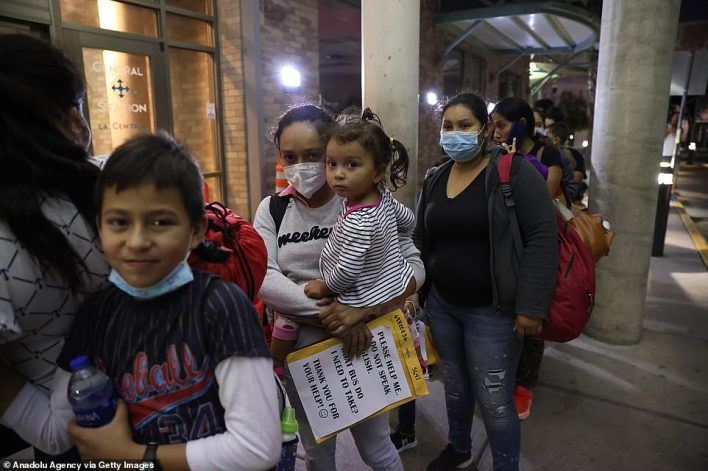 A group of migrants from Honduras, Guatemala and El Salvador arrives at a bus terminal in the U.S. after crossing the Rio Grande river from Mexico