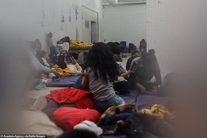 Migrants from Honduras, Guatemala and El Salvador are seen in a border facility on Wednesday