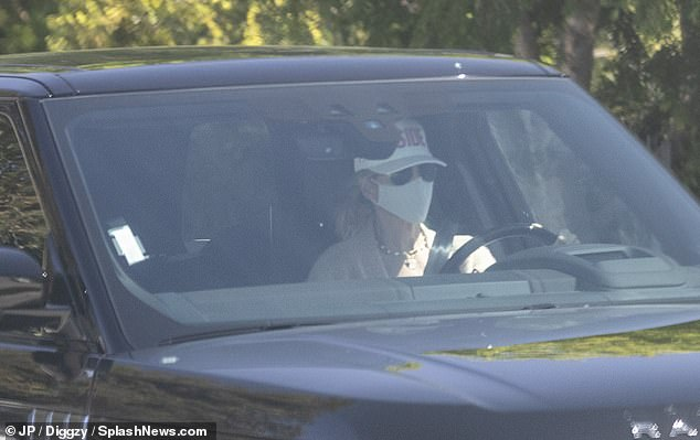 Pictured: Lori Loughlin seen for first time since husband Mossimo Giannulli's early release from prison... after his five month sentence for role in the college admissions scandal