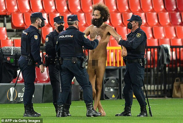 The man was detained by police after cameras caught him running across the turf at Granada