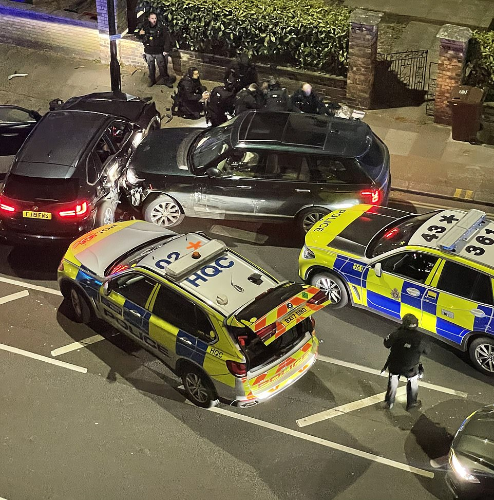 Pictures from the scene show the 4x4 had been boxed in by police in Chiswick, London, before the driver - who was known to Sir Richard - was carried away in a stretcher after he was found to have received 'a number of serious self-inflicted injuries'