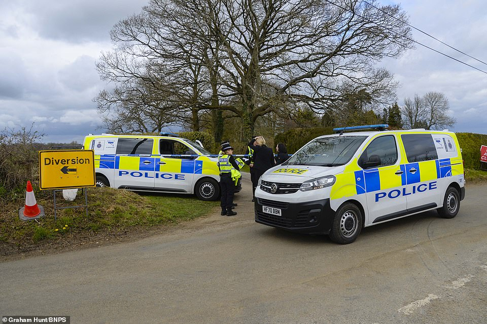 A woman, believed to be his wife, also suffered knife injuries in the attack at the home, named Moorhill. Pictured: Police at the scene yesterday
