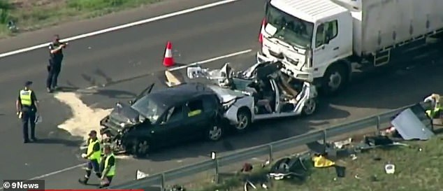 Pictured: A Toyota Corolla sandwiched between a Volkswagen and a truck on a major highway