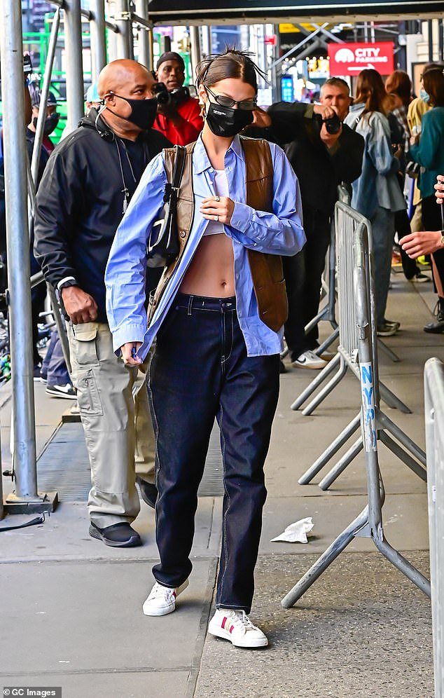 Turning heads:Bella was a sight to behold as she arrived to the fashion extravaganza working a leather vest, dark blue jeans, and white sneakers