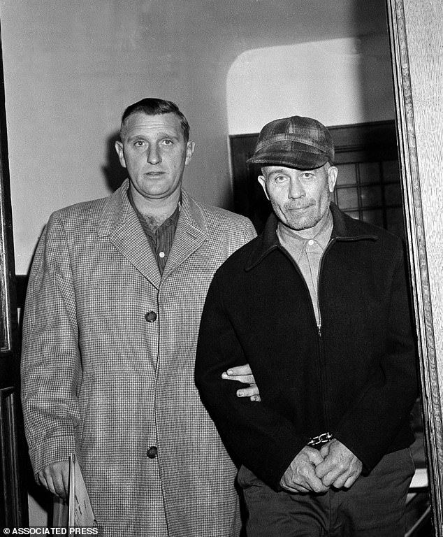 Waushara County Sheriff Art Schley, left, escorts Edward Gein, 51, of Plainfield, Wisc. into Central State Hospital for the Criminally Insane Nov. 23, 1957, in Milwaukee