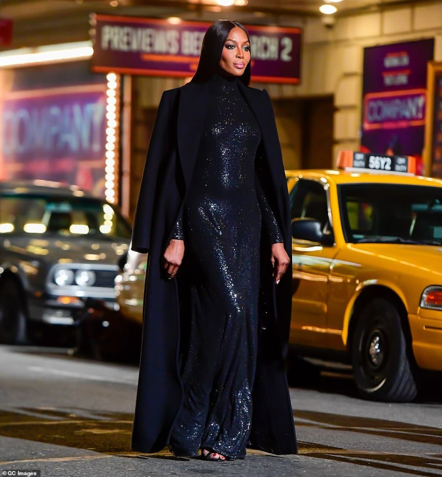 Back in black: Naomi looked as elegant as ever as she walked in the middle of the street while revealing her slinky black gown