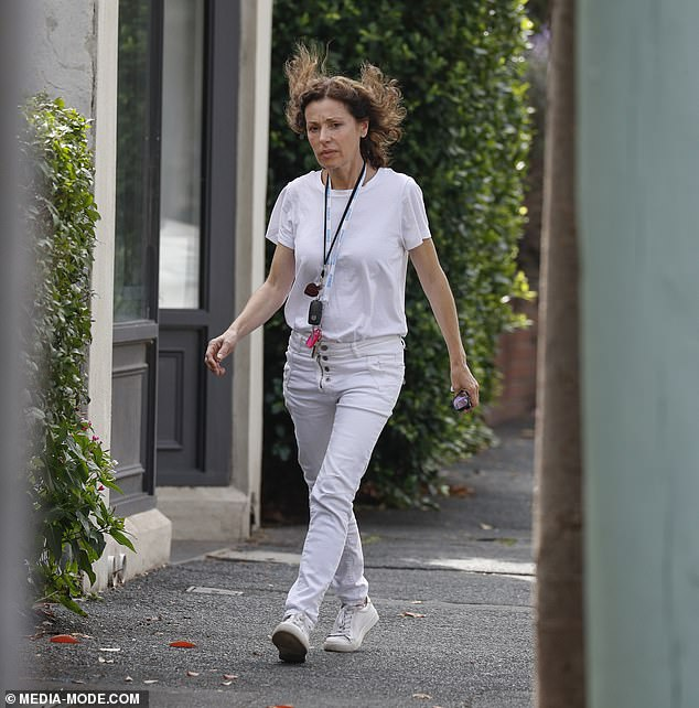 Radiant:Melbourne chanteuse Tina Arena, 53, looked positively ageless as she ran errands in Melbourne makeup free this week