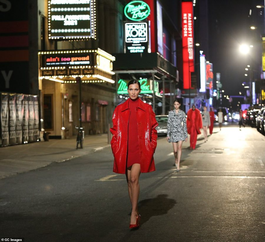 On parade: Bella led a string of models as they walked amid the shuttered theaters