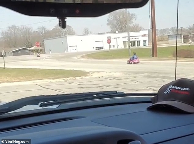 The clip then cuts to the woman driving the child's Jeep Wrangler down the road without a care in the world