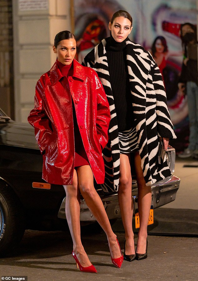 Strike a pose: At one point, she was seen posing against a car on the usually bustling city street, alongside fellow model Vittoria Ceretti, who looked sensational in a zebra-print coat