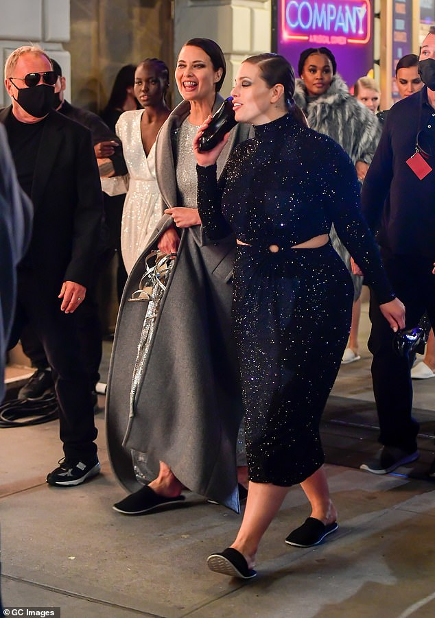 Wow: Ashley Graham wowed in a glittering black dress as she chatted away with fellow models