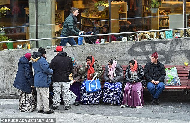 Pictured: Romany immigrants gather in Sergels Torg public square near Stockholm Central Station.Sweden opened its doors to thousands of migrants flooding into Europe in 2015 but has since been rocked by a surge in gang violence, bombings, shootings and sex attacks that has caused unrest. There has also been a rise in far-Right attacks