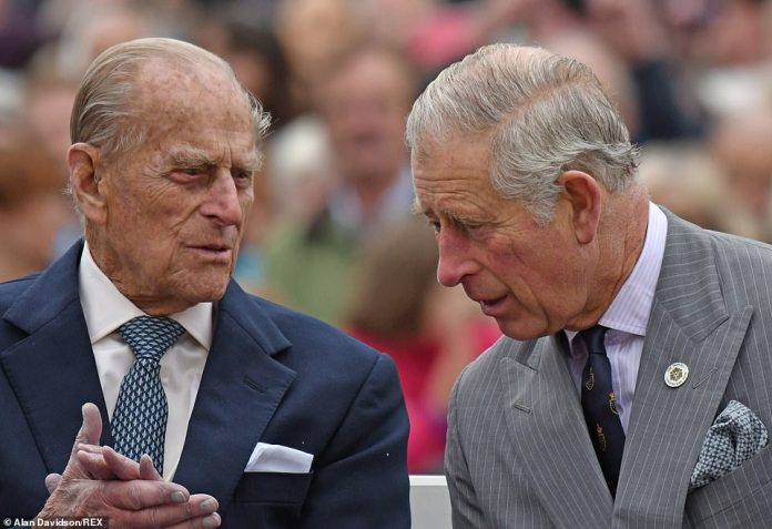 Prince Philip with Prince Charles at the unveiling of a statue of the Queen Mother, Poundbury, Dorset, October 2016